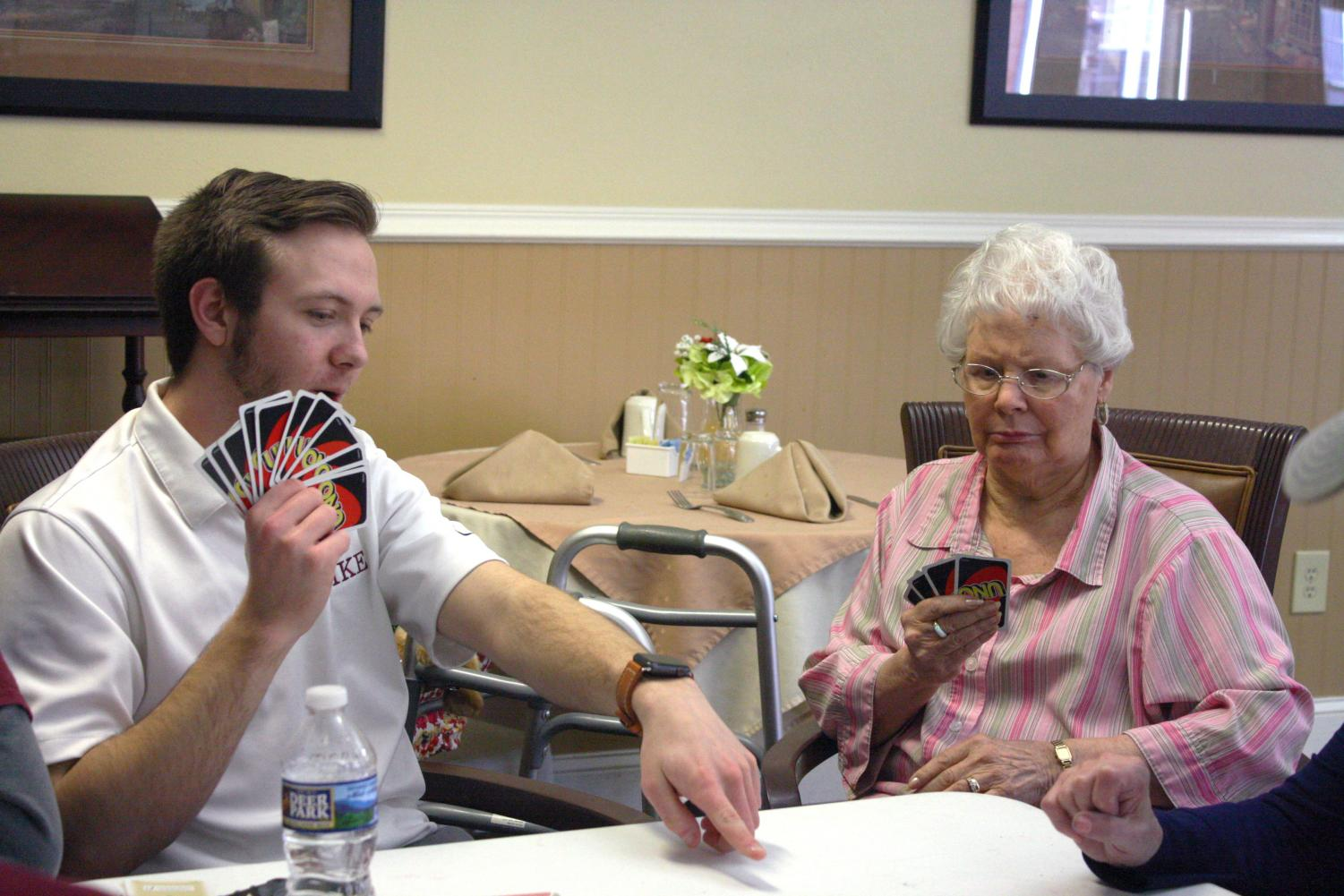 Will+explains+a+play+to+a+resident+during+a+game+of+UNO.