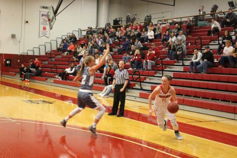 Junior Ariana Sandefur proceeds to drive past her defender in the first half against Asbury.