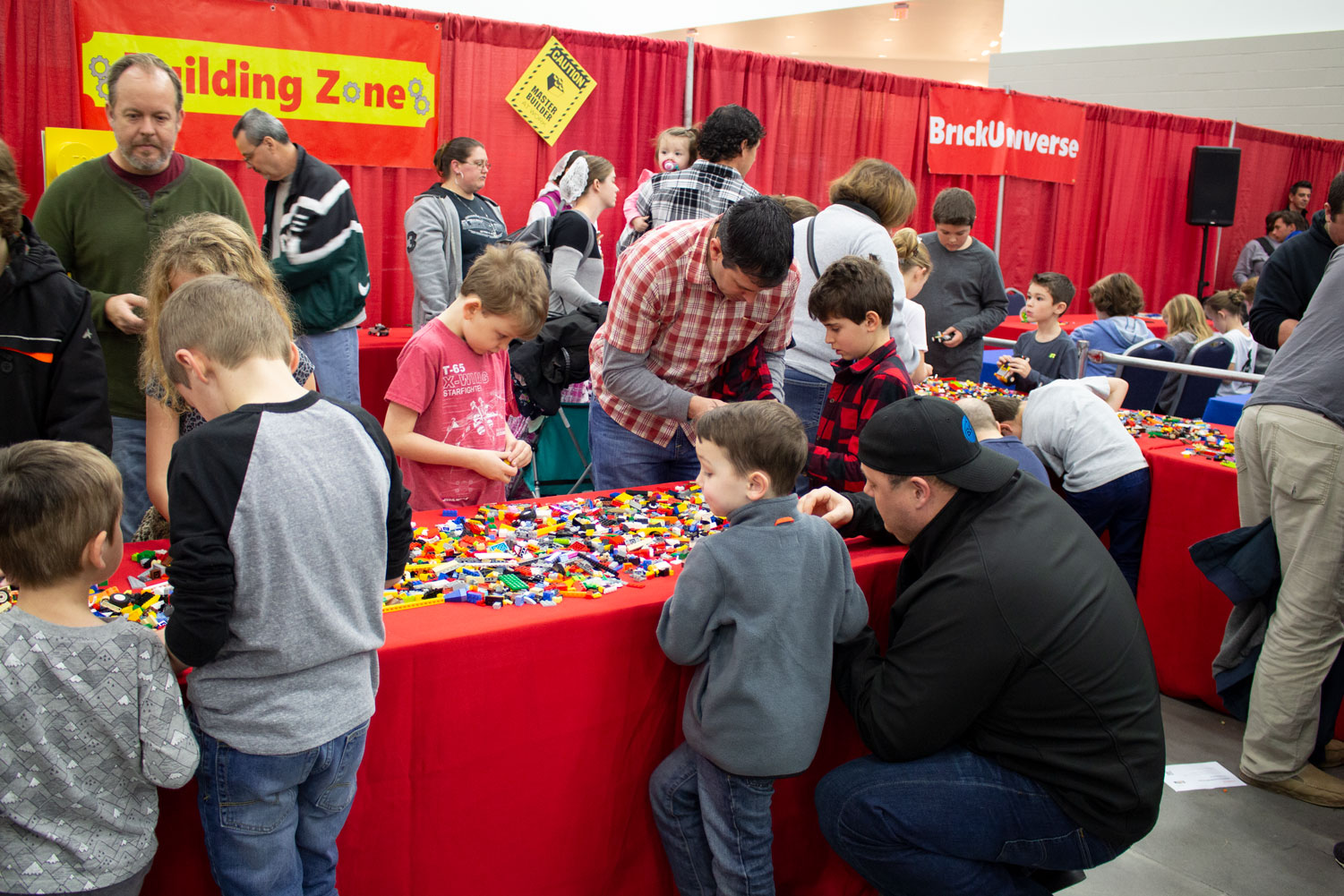 Children+and+guardians+gather+at+the+Lego+Building+Zone+to+create+projects+of+their+own.