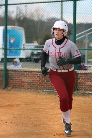 Senior Baylee Krueger heads for the dugout after scoring on a bases-loaded walk to Miranda Miller in game one of last Friday's doubleheader versus Midway University.
