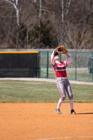 Second baseman Lindsey Nelson shields her eyes from the sun before catching an infield popup in game two of last Saturday's doubleheader versus Asbury University.