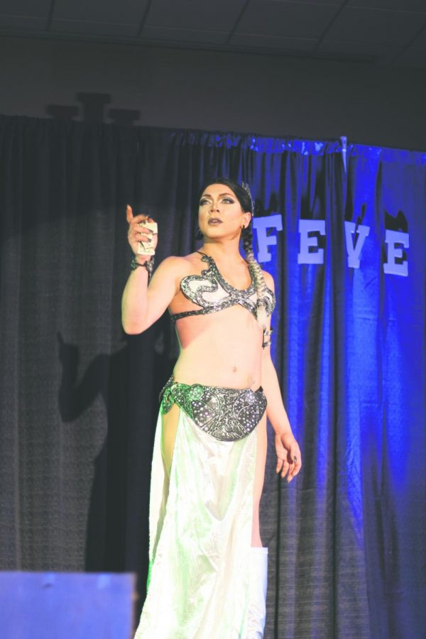 Satiné St. Claire, dressed as Princess Leia, performs her drag routine. Drag queens and kings perform choreographed lip-syncing and miming to music of their choice.