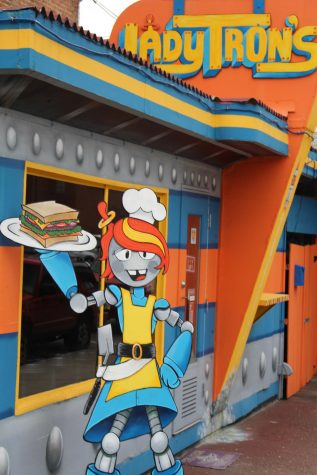 "A robot mascot sits outside the door of Lady Tron's diner. Owner Summer Sieg received the nickname ""Lady Tron"" years ago and it became her diner's namesake."