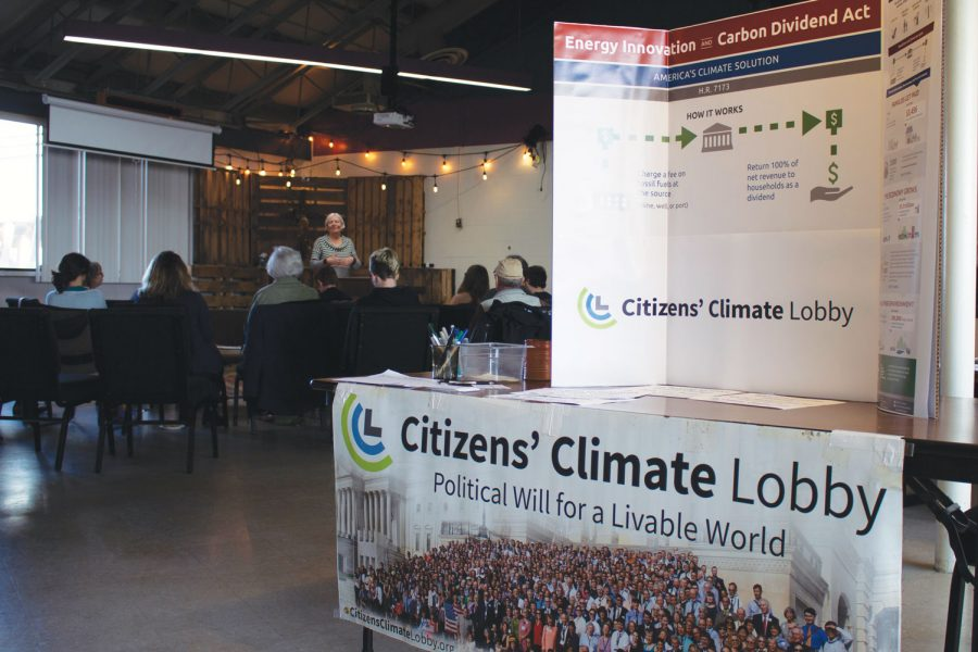 As Veldman runs the climate workshop, the CCL's information booth stands at the entrance, greeting new attendees. Flyers and packets were handed out to all in attendance.