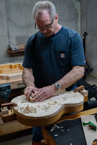 Mabe uses a hand plain to level out the front plate for a guitar. Very little of his work is done with power tools.