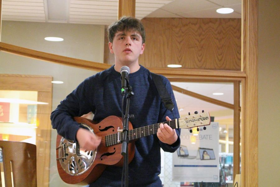 Jacob+Howard%2C+a+freshman+who+is+an+English+Education+Major%2C+sings+%E2%80%9CMichael%E2%80%9D+by+Red+House+Painters+while+playing+his+guitar.+%E2%80%9CMy+parents+started+getting+me+guitar+lessons+and+I+hated+it+but+once+I+started+listening+to+music%2C+I+was+like%2C+%E2%80%98oh%2C+this+might+be+worthwhile.%E2%80%99++I+like+performing...and+I+love+that+song+too.%E2%80%9D