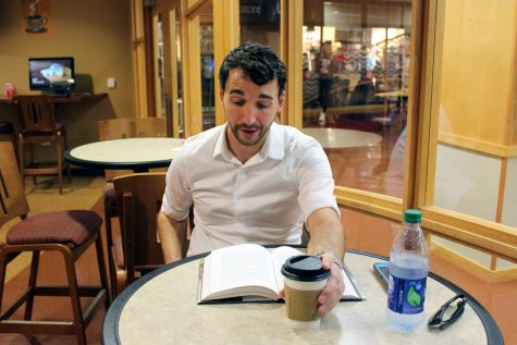 Matthew Goldberg, adjunct history professor at IU Southeast, sits in the University Grounds Coffee Shop, enjoying a cup of coffee and a book as he takes a moment to relax from his hectic schedule.
