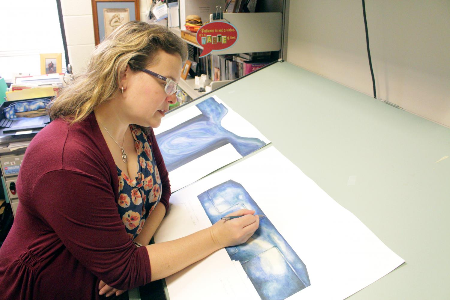 Professor Rebekka Meixner-Hanks diligently works on a new stage set she is designing for the IU Southeast Theatre Department.