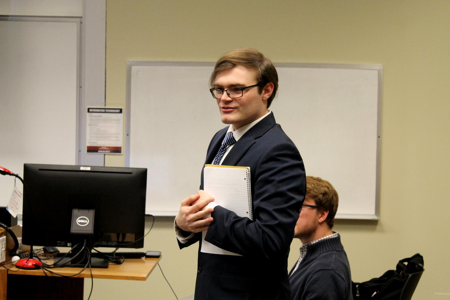SGA President Grant Hill shares his officer report at the SGA's weekly meeting.