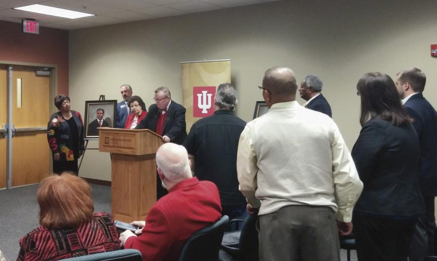 IU+Southeast+Chancellor+Wallace+speaks+behind+a+lecturn+during+the+Neal-Marshall+Portrait+Dedication.