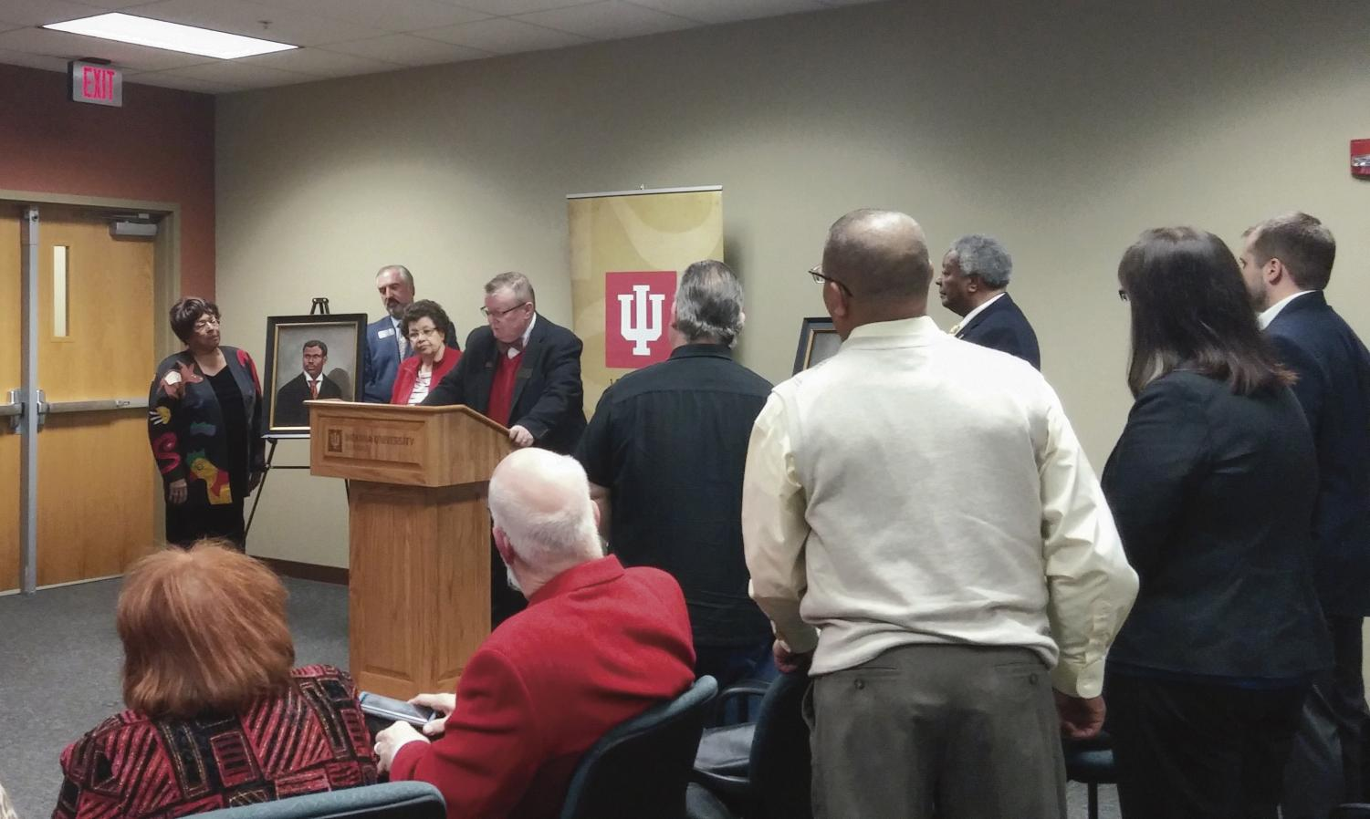 IU Southeast Chancellor Wallace speaks behind a lecturn during the Neal-Marshall Portrait Dedication.