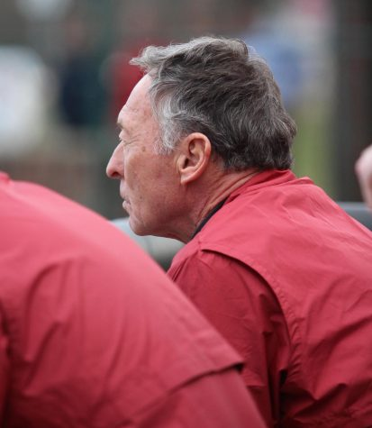 IUS Bench Coach Dave Collins looks on from the dugout during the Grenadiers home opener against Georgetown College on February 3, 2020.
