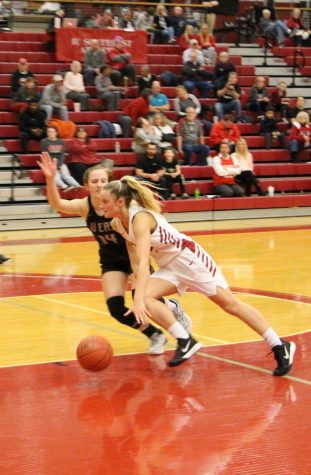 IUS sophomore Lauren Lambdin tries to drive past IU East's Addie Brown during the second half of the Grenadiers' RSC Quarterfinal victory over the Red Wolves.