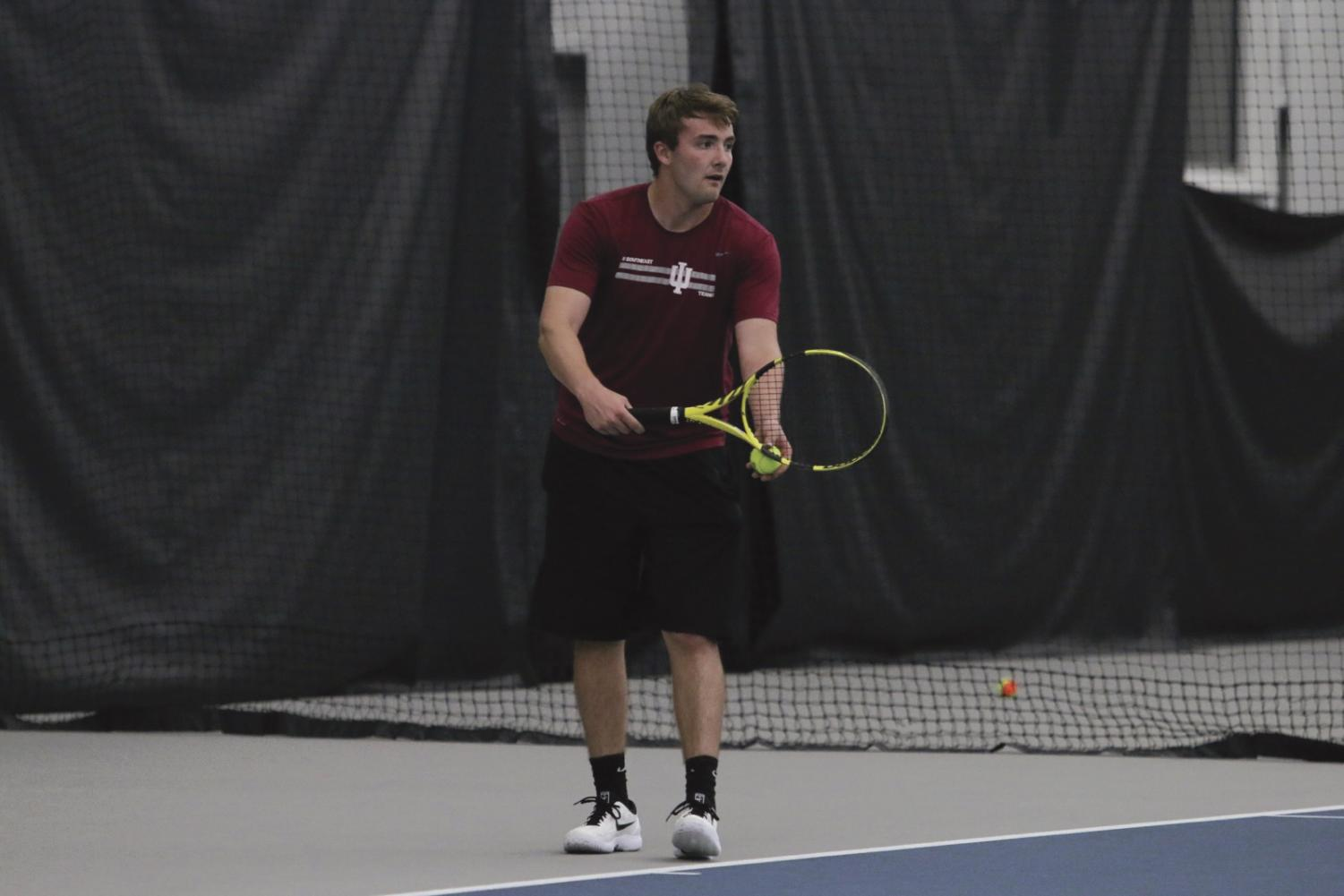 Brock Winchell prepares to serve during a match against Asbury University on April 11, 2019.