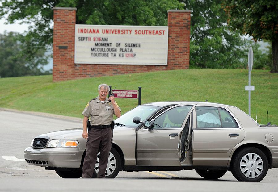 Police blocked the entrances to Indiana University Southeast after reports of a gunman on campus Thursday afternoon. The false alarm, which was actually a large umbrella in a camouflage backpack, was cleared after about an hour long sweep across campus. Photo by Tyler Stewart/News and Tribune (used with permission).