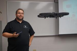 Adam Maksl, assistant professor of journalism , flies his drone in class.