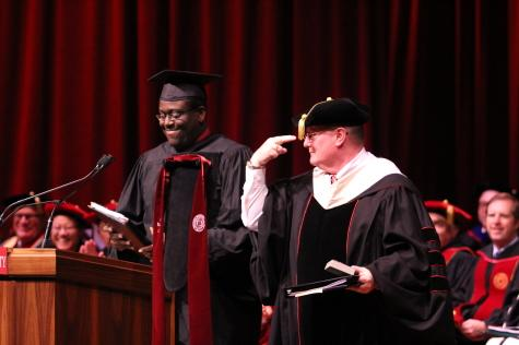 Chancellor Wallace acknowledges his wife, Susan Wallace, after he is given an IU tie by SGA President Stephon Moore. Moore said Susan Wallace gave him the idea for the gift.