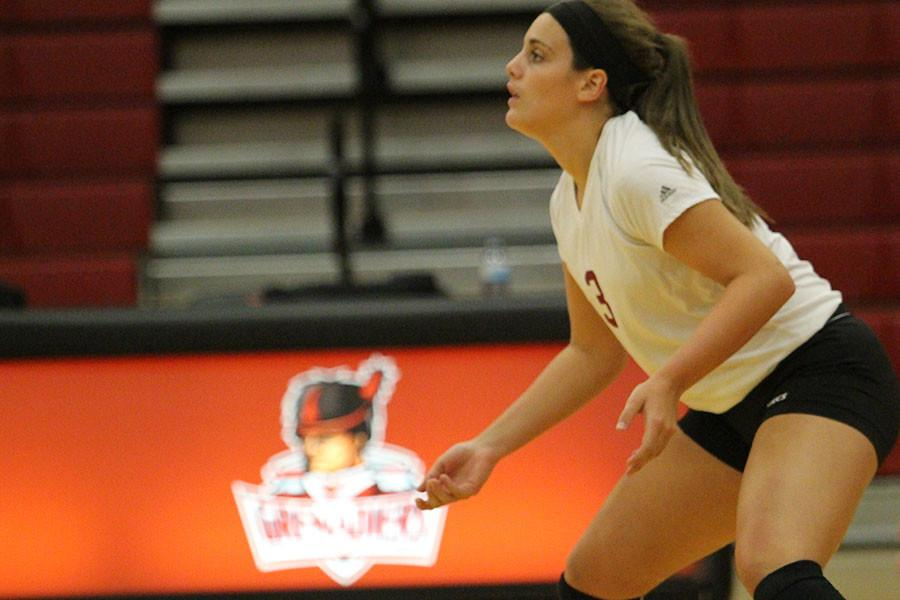 Maddie+Jacobi%2C+freshman+defensive+specialist%2C+gets+ready+for+a+serve+in+Thursday%27s+game+against+Spalding+University.+The+Grenadiers+beat+the+Golden+Eagles+in+their+home+opener+.