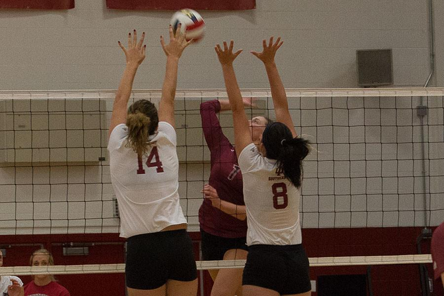 Sophomores+Michala+Beasley+and+Kelsey+Willinger+go+up+for+a+block+against+IU+East+on+Thursday%2C+Sept.+10.+The+Grenadier%27s+defense+was+great+getting+four+blocks+against+the+Red+Wolves.