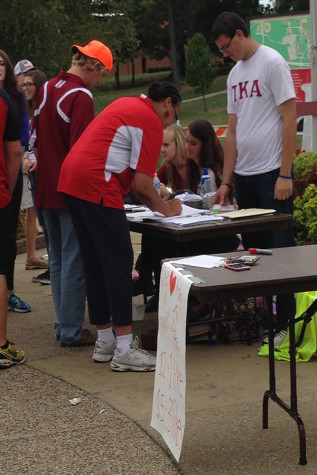 Dakota Brooks, education junior and 21st Century Scholar support specialist, and Channell Barbour, associate director of Campus Life, sign up for the fire truck pull.