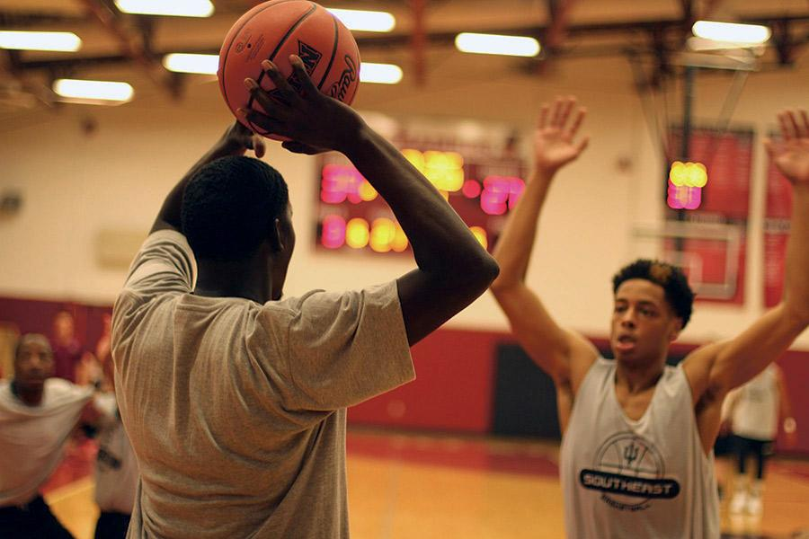 Jalen Brasher, freshman guard, guards a player in the IUS alumni game on Wednesday, Oct. 14. The Grenadier's season begins Oct. 24 against Harris-Stowe State College.