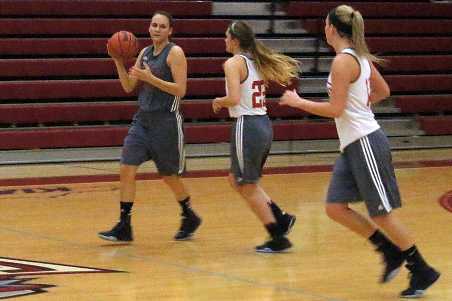 Three IUS women's basketball players do a fast break drill during practice . The Grenadiers were 19-12 last season under coach Robin Farris.