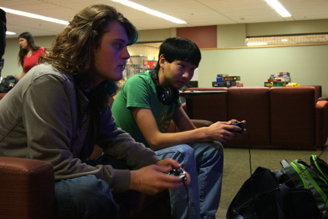 Photo by Katie Casper Sevyn Tripton, biology junior, with Jackson Kerly, informatics and computer networking sophomore, playing Super Smash Bros on the Wii during Thursday night game night.