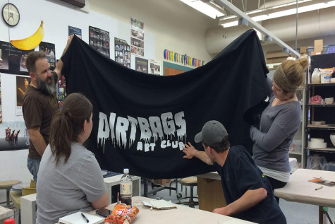 Photo courtesy of Bethany Barton Dirt Bags Art Club members looking at their logo designed by Parker Bolin.