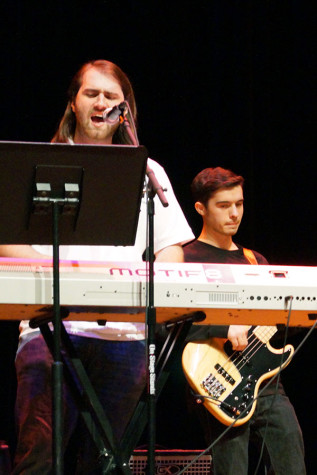 Curtis Merrill, music senior, and Bobby Conley, music sophomore, perform as AMC in Fallstock. AMC is the cover rock band in Sound Together.