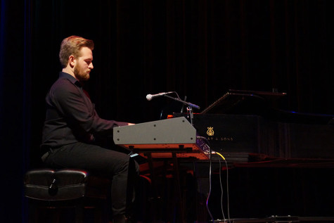Ethan Miller, prospective music junior, plays the piano during Cold Front's performance in Fallstock.
