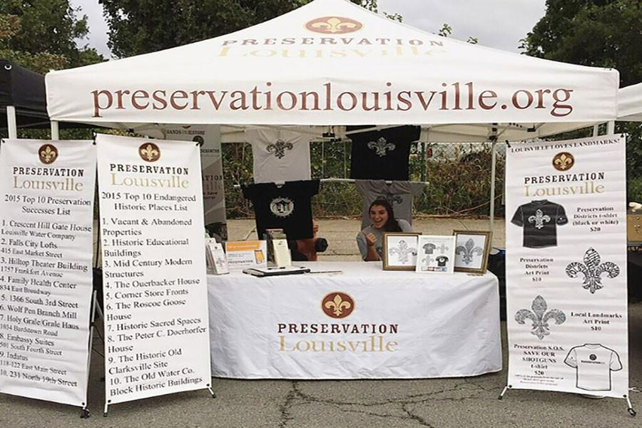 Lissa+Gamsky%2C+international+business+junior%2C+at+the+Preservation+Louisville+booth+at+the+NuLu+Festival.