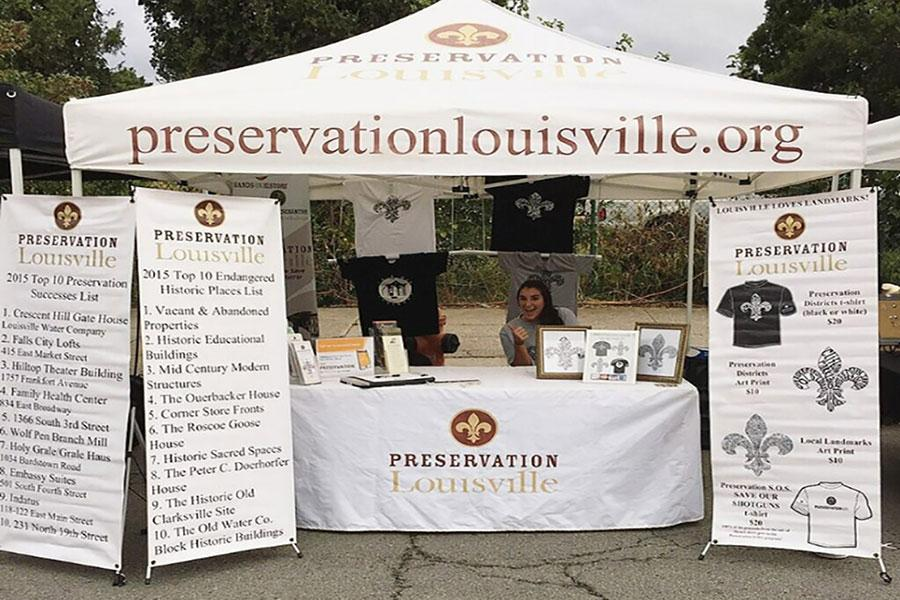 Lissa Gamsky, international business junior, at the Preservation Louisville booth at the NuLu Festival.
