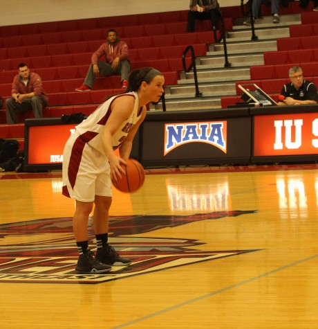 Thomas sets up the offense in the first quarter. The Grenadiers would go on to win by 47 points.