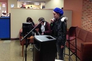 Nichole Thomas ends her Open Mic time slot with a 60's rap song.