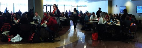 The tables in The Commons fill up as students gather to eat lunch with friends and listen to Haley's music.