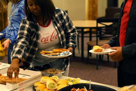 While watching the Super Bowl, Wallace provided the IU Southeast students with food.