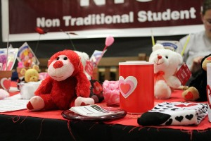 A stuffed monkey and fake candle was for sale at the NTSU Valentine's Day event table.