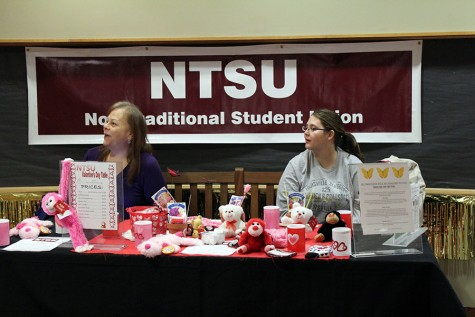 Daiyu Hurst, informatics senior and NTSU president, and Amber Bower, psychology junior and NTSU member, talk to a student about their organization.