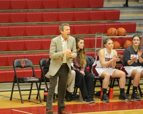 Head coach Robin Farris instructs his team late in the fourth quarter. The Grenadiers lose in overtime by one, 96-97.