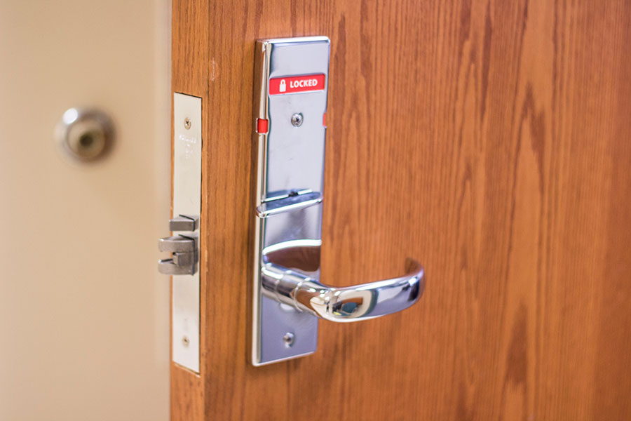 The door of Knobview Hall, room 207, is one of many doors in Knobview that have had new thumb locks installed.
