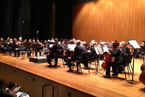 The Louisville Orchestra warms up for its performance.