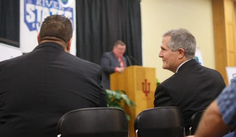 Commissioner Scott McClure and Athletic Director Joe Glover share a look at the press conference.