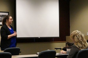 Annell Lough, outreach advisor for the Center for Women and Families, wraps up her discussion by taking questions as Melissa Fry, assistant professor of sociology and director of the Applied Research and Education Center at IU Southeast, and another attendee listen to her answers.