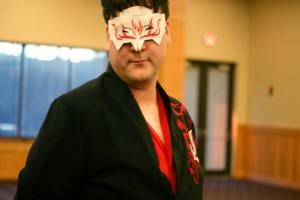 """Michael Hartsfield, unaffiliated cosponsor for the Spring Ball, wears the regalia of """"RWBY"""" anime character Adam Taurus. Hartsfield said he came to the event to offer support to friends."""
