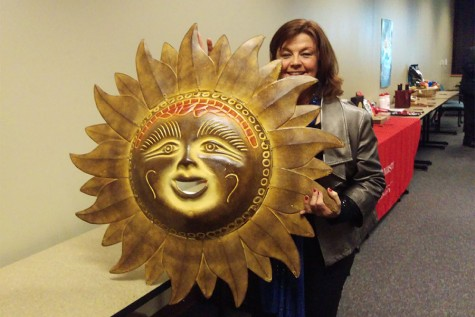 Cheryl Neal, IUS alumna who received a Bachelor of Science in psychology in 1987 and a Master of Science in education in 1990, won the Mexican sun wall hanging during the silent auction that occurred during the Field Biology program's event, 20 Countries in 20 Years.