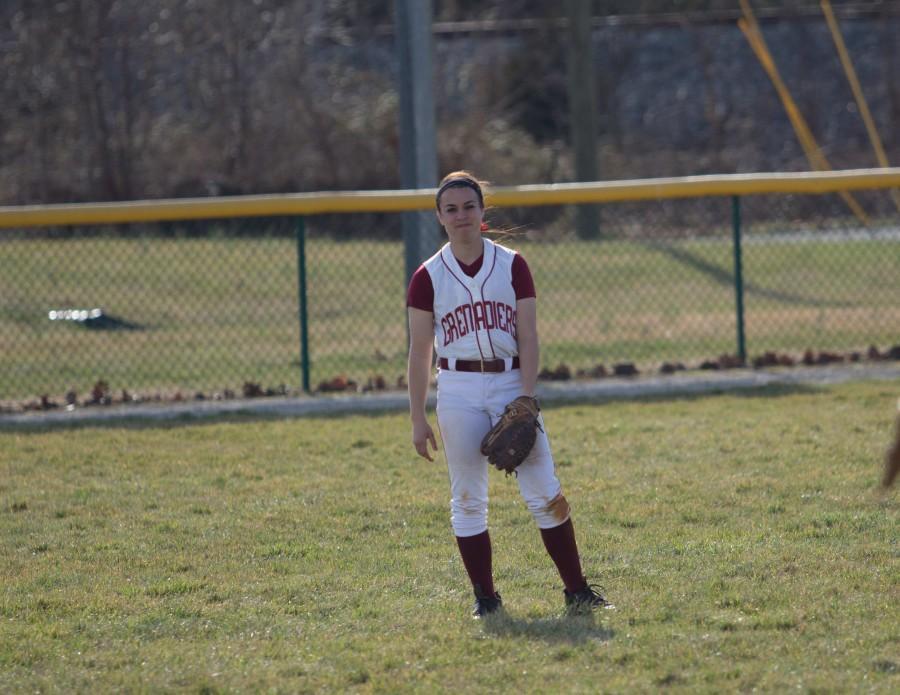 Junior+outfielder+Brooke+Barnett+warming+up+between+innings.