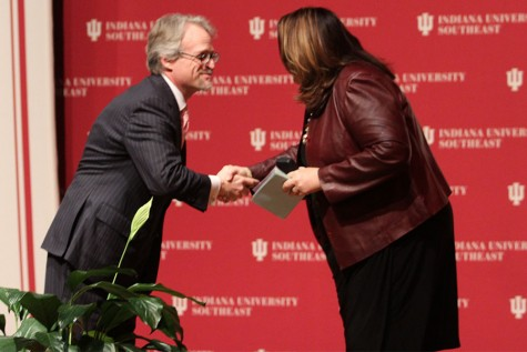 Jay White, dean of the School of Business and associate professor of finance, shakes Candy Crowley's hand before she begins her speech.