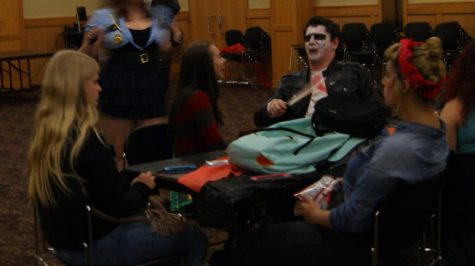 Partygoers talking among themselves during the Halloween Party. Later, they would take to the dance floor and dance to some hit dance songs.