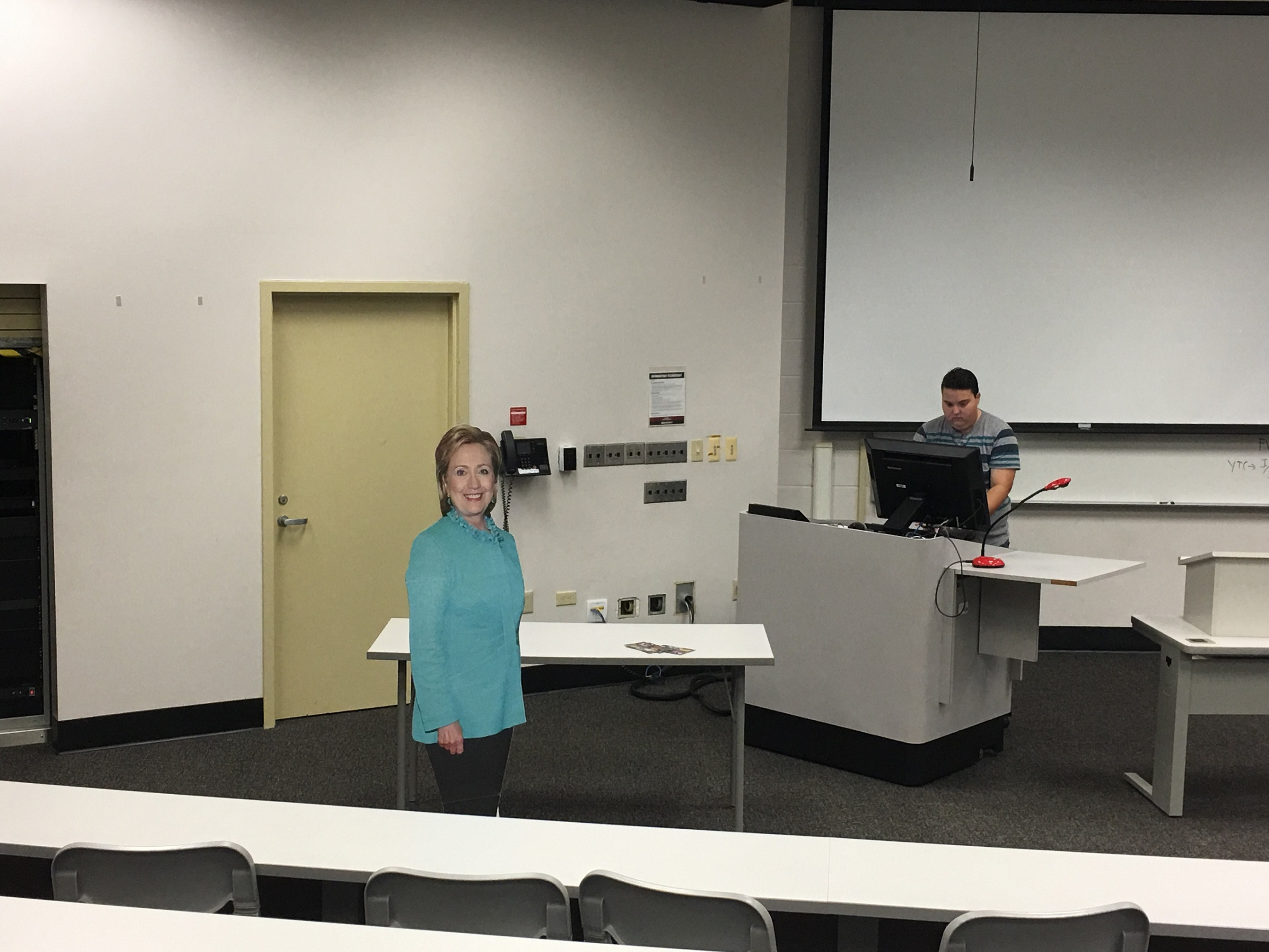 Students+set+up+a+cardboard+cutout+of+Hillary+Clinton+before+the+presidential+debate+began.