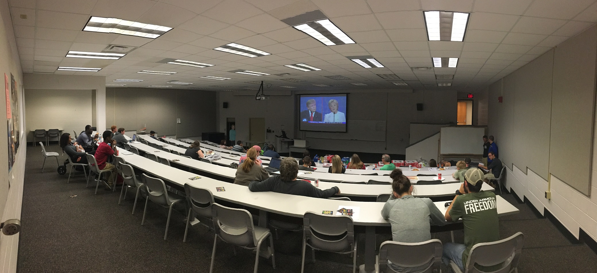 Students+watch+as+the+two+candidates+debate.